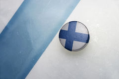 Old hockey puck with the national flag of finland. Royalty Free Stock Photos