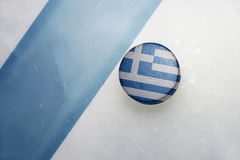 Old hockey puck with the national flag of greece. Stock Image