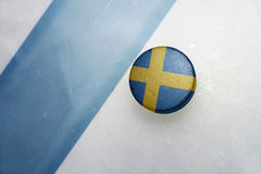 Old hockey puck with the national flag of sweden. royalty free stock image