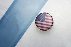Old hockey puck with the national flag of united states of america. stock images