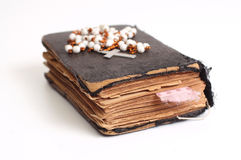 Old holy bible. With cross and pink ribbon Stock Images
