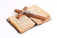 Old holy bible. Open old holy bible with wood cross Stock Photography
