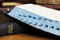 Old Bibles One Open over Closed Book. Stock Images