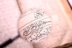 Old holy quran book. With magnifying glass Royalty Free Stock Photography