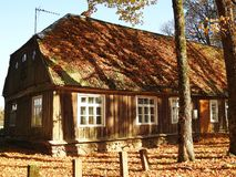 Old home and autumn leaves, Lithuania stock photography