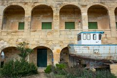 Old home with and and old boat. royalty free stock photo