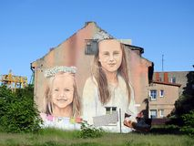 Old home with painted girls, Lithuania Stock Image