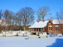 Old home and ships in winter, Lithuania Royalty Free Stock Images