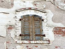 Old home wall with closed window stock image
