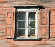 Old home wall and window, Latvia. Beautiful old wooden  home wall and window with shutter royalty free stock photography