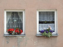 Old home wall and windows. Old home wall, windows and flowers, Lithuania Stock Photos