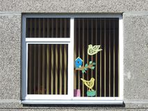 Old home window with decoration cut from paper, Lithuania royalty free stock images