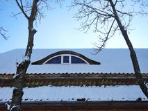 Old home window and roof, Lithuania. Old home roof, window and beautiful trees royalty free stock photos