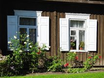 Old home windows and flowers, Lithuania Stock Photos