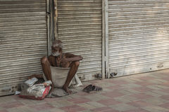 Old homeless man. DELHI INDIA-JUN 19 : homeless man live on pavement in chandni chowk in old delhi of Delhi on june, 19, 2015, india Royalty Free Stock Photography