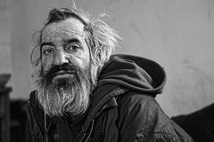 Old homeless man sitting in abandoned house. Homeless man sitting in old abandoned house Stock Images