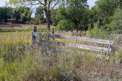 The old homeplace gate. Old wooden gate to a pasture in the countryside Royalty Free Stock Photography