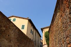 Old homes and brick walls in an ancient European town stock image