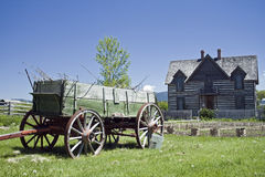 Old Homestead. An old wagon sits in front of an old homestead in Montana Royalty Free Stock Photography