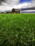 Old Homestead in Field Stock Photo