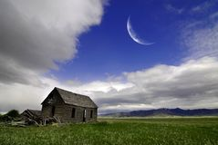 Old Homestead in Field and Moon Stock Images