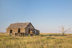 Old homestead on prairie Stock Photo