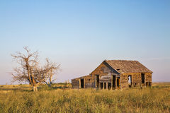 Old homestead on prairie Stock Photography