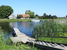 Home and river Minija in summer , Lithuania Royalty Free Stock Photography