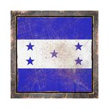 Old Honduras flag. 3d rendering of a Honduras  flag over a rusty metallic plate in an old frame. Isolated on white background Stock Images