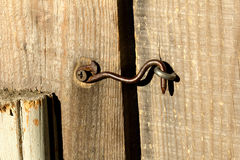 Old hook on the door Royalty Free Stock Photo