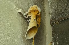 Old hooter on the wall. Old factory hooter. Close-up. Stock Image