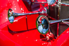 Old horns at an antique vintage red car Royalty Free Stock Photos