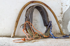 Old horse collar near wall Stock Image