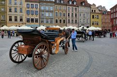 Old horse-drawn carriage In the market square of Warsaw royalty free stock photos