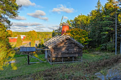 Old horse drawn mill and windmill Stock Images
