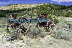 Old Horse Drawn Wooden Antique Wagon in Foothills of Colorado Royalty Free Stock Photography