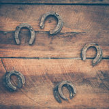 Old horse shoe. On wood background royalty free stock photography
