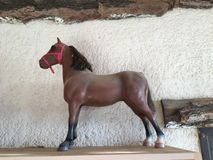Old horse toy on the background of old wall stock images