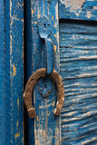 Old horseshoe hanging on the door handle Royalty Free Stock Photo