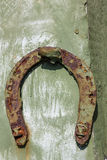 Old horseshoe. Very old rusty horseshoe nailed to the fence stock photo