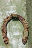 Old horseshoe. Very old rusty horseshoe nailed to the fence Stock Photo