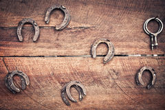 Old horseshoe on wood Stock Photo