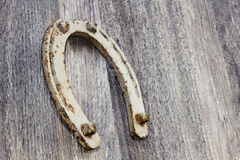 Old horseshoe on a wooden background Stock Photos