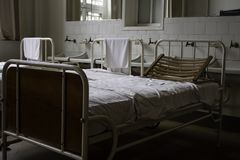 Old hospital beds. Detail of old hospital for patients royalty free stock images
