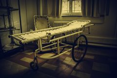 Old hospital gurney. Antique hospital stretcher, bed detail for patients royalty free stock photos
