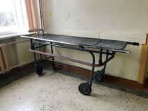The old hospital from the inside. Hospital cart for the transportation of patients for surgical operations. The old hospital from the inside. Hospital cart for Stock Images