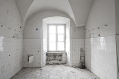 Old hospital room. Old, abandoned hospital room whit white tiles Royalty Free Stock Photos