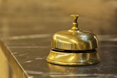 Old hotel bell on a marble stand Royalty Free Stock Photos