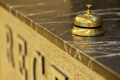Old hotel bell on a marble stand Royalty Free Stock Photo