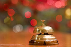 Old hotel bell on a wood stand. At Christmas stock photos